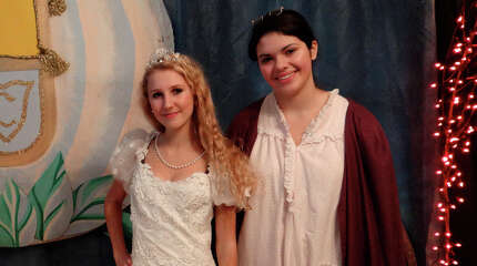 Dominika Michalska, 17, as Cinderella, and Melanie Nelson, 16, as the Fairy Godmother, at the Enchanted Castle at Burr Homestead on Saturday.