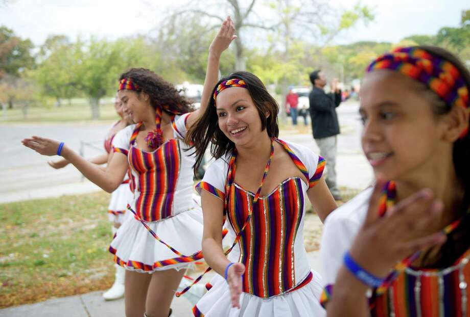 Members of the Rinos Latin Band help lead the Mayor's Children's Parade at Cummings Beach in Stamford, Conn., on Saturday, October 18, 2014. The parade was followed by an International Festival. Photo: Lindsay Perry / Stamford Advocate