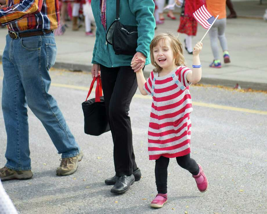 Kids and their families march in the Mayor's Children's Parade at Cummings Beach in Stamford, Conn., on Saturday, October 18, 2014. The parade was followed by an International Festival. Photo: Lindsay Perry / Stamford Advocate