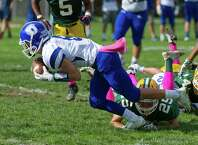 Darien's Colin Minicus dives into the endzone for a touchdown after recovering a loose ball during Saturday's football game at Trinity Catholic High School in Stamford, Conn., on October 18, 2014.