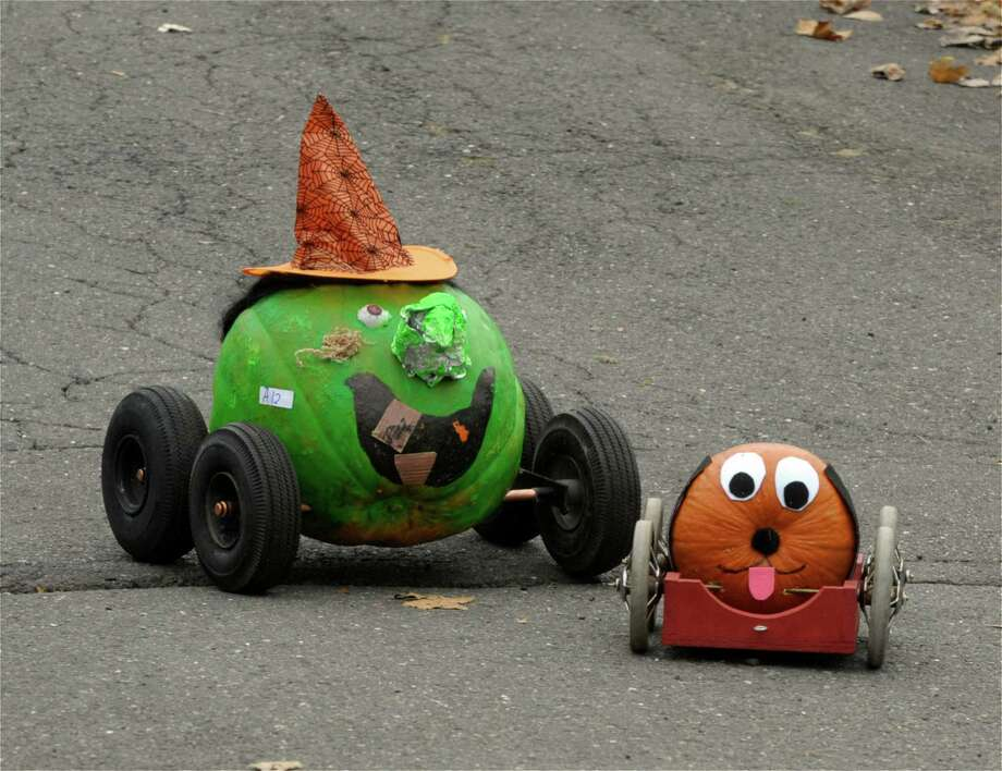 Two pumpkins race in the  5th Annual Great Pumpkin Race, in Newtown, Conn, on Saturday, October 18, 2014. Photo: H John Voorhees III / The News-Times Staff Photographer