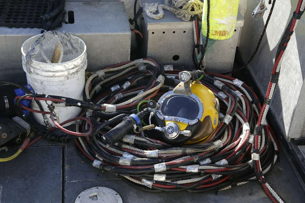A Port of San Francisco maintenance crew was on hand with dive gear during the search for human remains on Saturday, October 18, 2014, near Pier 50 on the San Francisco waterfront.