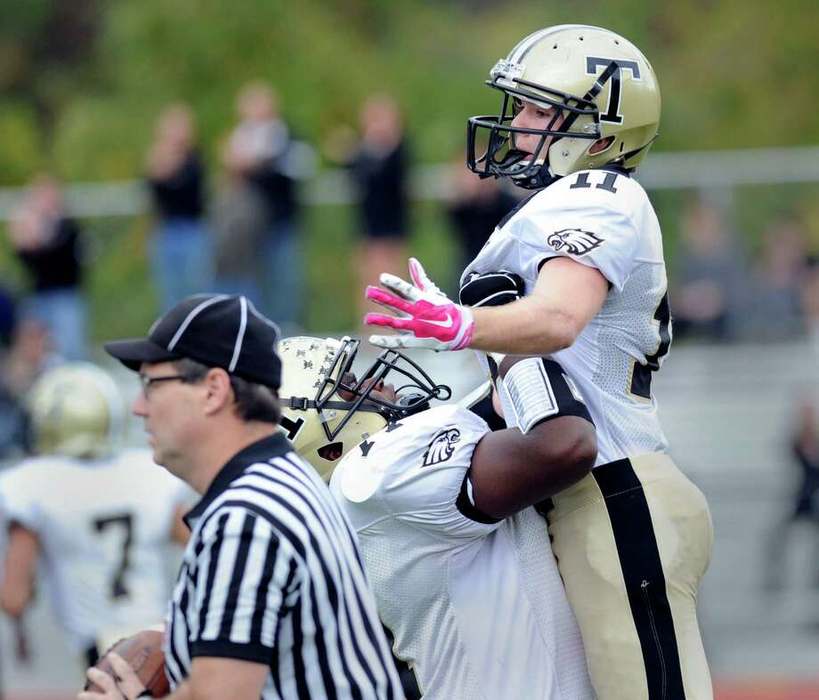 Trumbull's Stephen Nagy (#11), right, celebrates with a teammate after Nagy made a catch for a touchdown during the high school football game between Greenwich High School and Trumbull High School at Greenwich, Conn., Saturday afternoon, Oct. 18, 2014. Photo: Bob Luckey / Greenwich Time