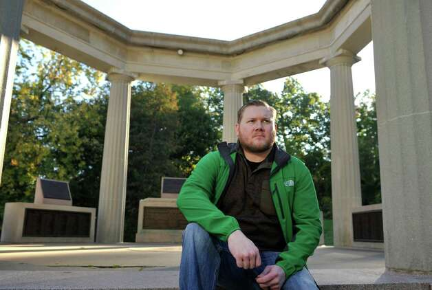 Army veteran Andy Davis poses at the war memorial in Congress Park on Thursday, Oct. 9, 2014, in Saratoga Springs, N.Y. Davis, an Army Ranger, served in Iraq in 2003 during the invasion.  (Paul Buckowski / Times Union) Photo: Paul Buckowski / 10028961A