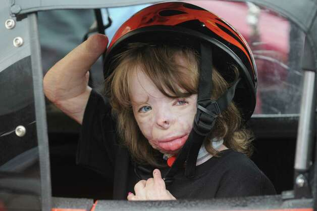 Seven-year-old Sa'Fyre Terry gets seated in the side car of Don Philips bike before the Sa'fyre's Ride a motorcycle ride to benifit her on Saturday Oct. 18, 2014 in Schenectady, N.Y.  (Michael P. Farrell/Times Union) Photo: Michael P. Farrell / 00029082A