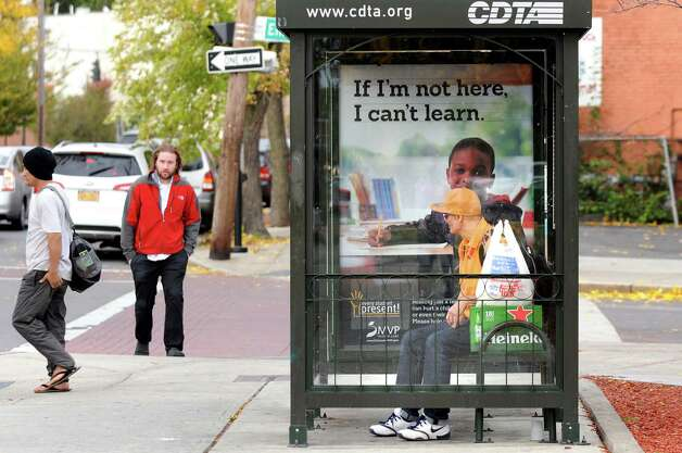 A man waits at the bus stop after shopping at Price Chopper on Thursday, Oct. 16, 2014, in Albany, N.Y. (Cindy Schultz / Times Union) Photo: Cindy Schultz / 00029055A
