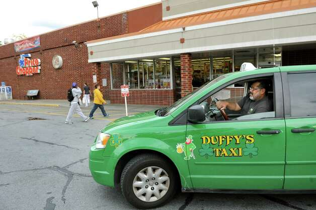 Harry E. Wright drives his taxi through the parking lot looking for riders on Thursday, Oct. 16, 2014, at Price Chopper in Albany, N.Y. Wright said this was one of his regular stops to pick up shoppers looking for a ride home. (Cindy Schultz / Times Union) Photo: Cindy Schultz / 00029055A