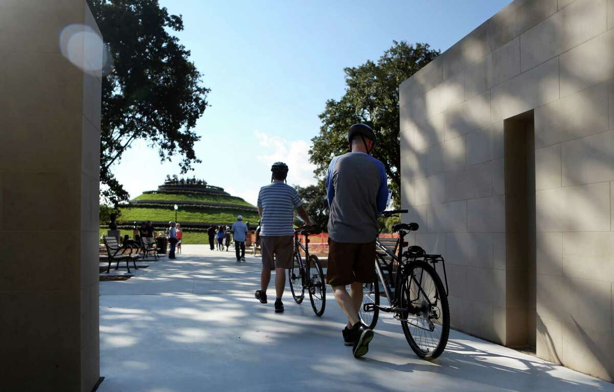 Visitors enter The McGovern Centennial Gardens which is open to the public for one day until it is completely finished on Saturday, Oct. 18, 2014, in Houston.