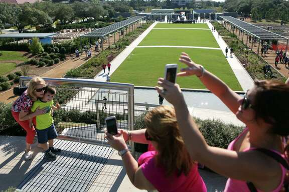 Diana Barnes and Sebastian De La Garza are photographed by Iris De La Garza on top of the 30' Garden Mount that overlooks the Great Lawn at The McGovern Centennial Gardens which is open to the public for one day until the project is completely finished on Saturday, Oct. 18, 2014, in Houston. The McGovern Centennial Gardens is the Conservancy's largest improvement project ever undertaken, and it has completely transformed the existing 15-acres Garden Center.