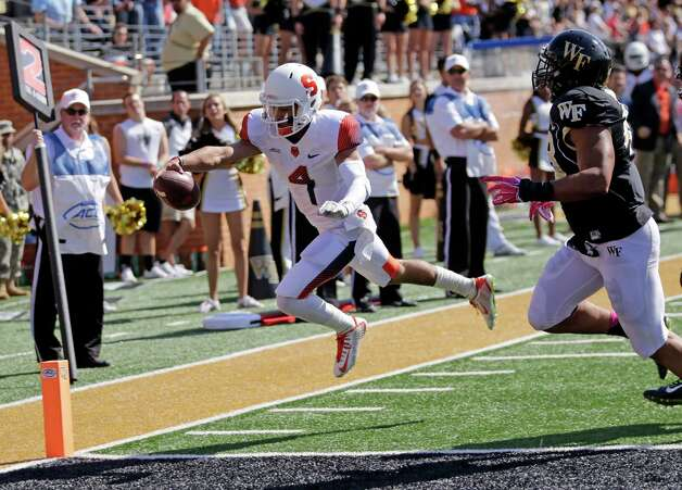 Syracuse's AJ Long (4) dives for the end zone for a touchdown as Wake Forest's Brandon Chubb (48) pursues during the first half of an NCAA college football game in Winston-Salem, N.C., Saturday, Oct. 18, 2014. (AP Photo/Chuck Burton) ORG XMIT: NCCB101 Photo: Chuck Burton / AP