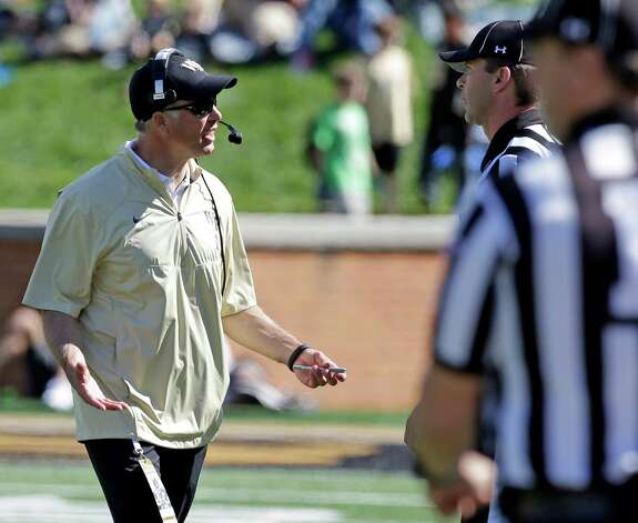 Wake Forest head coach Dave Clawson, left, argues a call with officials during the second half of an NCAA college football game against Syracuse in Winston-Salem, N.C., Saturday, Oct. 18, 2014. Syracuse won 30-7. (AP Photo/Chuck Burton) ORG XMIT: NCCB112 Photo: Chuck Burton / AP