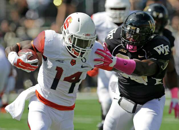Syracuse's Ervin Philips (14) is tackled by Wake Forest's Brandon Chubb (48) during the first half of an NCAA college football game in Winston-Salem, N.C., Saturday, Oct. 18, 2014. (AP Photo/Chuck Burton) ORG XMIT: NCCB106 Photo: Chuck Burton / AP