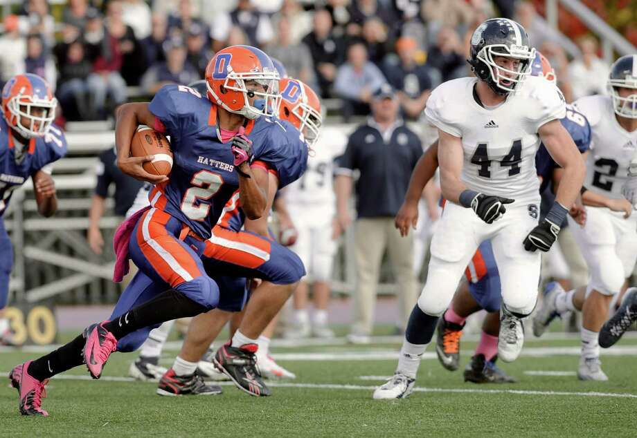 Danbury's quarter back Anferny Ith (2) keeps the ball on the option during the Staples and Danbury High School boys football game on Saturday, October, 18, 2014, in Danbury, Conn. Photo: H John Voorhees III / The News-Times Staff Photographer