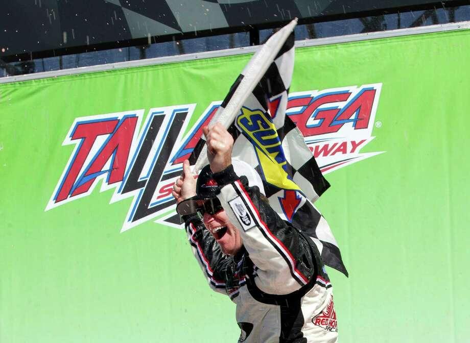 Timothy Peters reacts after winning the NASCAR Camping Truck series auto race at Talladega Superspeedway, Saturday, Oct. 18, 2014, in Talladega, Ala. (AP Photo/John Bazemore) ORG XMIT: ALJB114 Photo: John Bazemore / AP