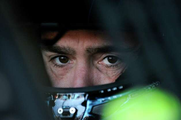 NASCAR driver Jimmie Johnson sits in his car as he waits to practice for Sunday's NASCAR Sprint Cup Series auto race at Talladega Superspeedway Friday, Oct. 17, 2014, in Talladega, Ala.  Johnson has one shot to keep his bid for a record-tying seventh championship going. The defending NASCAR champion must win at Talladega to avoid elimination from the Chase. (AP Photo/Rainier Ehrhardt)   ORG XMIT: ALJB101 Photo: Rainier Ehrhardt / FR155191 AP