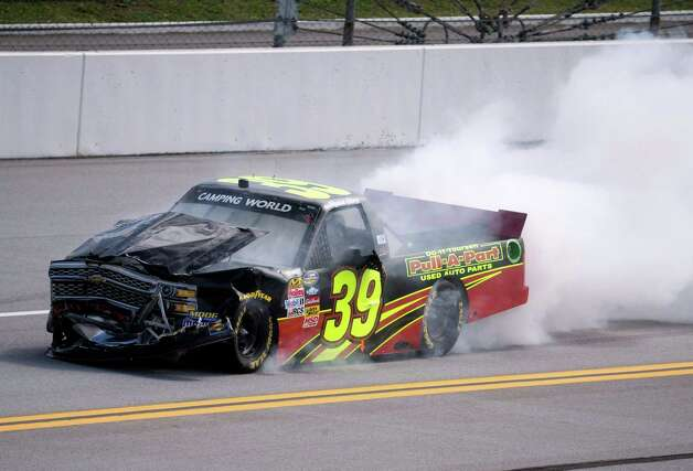 Driver Ryan Sieg pulls his damaged truck off the track after crashing along the backstretch during the NASCAR Truck series auto race at Talladega Superspeedway Saturday, Oct. 18, 2014, in Talladega, Ala. (AP Photo/John Bazemore)   ORG XMIT: ALJB105 Photo: John Bazemore / AP