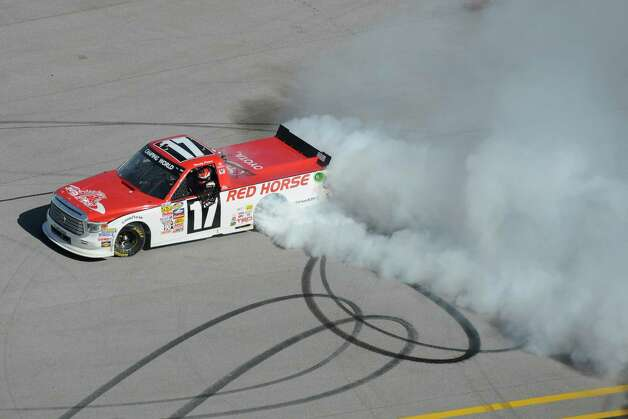 Driver Timothy Peters does a burnout as he celebrates after winning the NASCAR Truck series auto race at Talladega Superspeedway Saturday, Oct. 18, 2014, in Talladega, Ala.   (AP Photo/Rainier Ehrhardt)   ORG XMIT: ALJB112 Photo: Rainier Ehrhardt / FR155191 AP