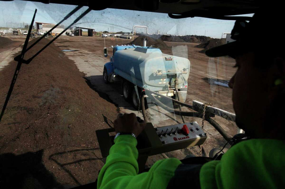Jose Jimenez drives the windrow turner, used to rotate rows of compost.