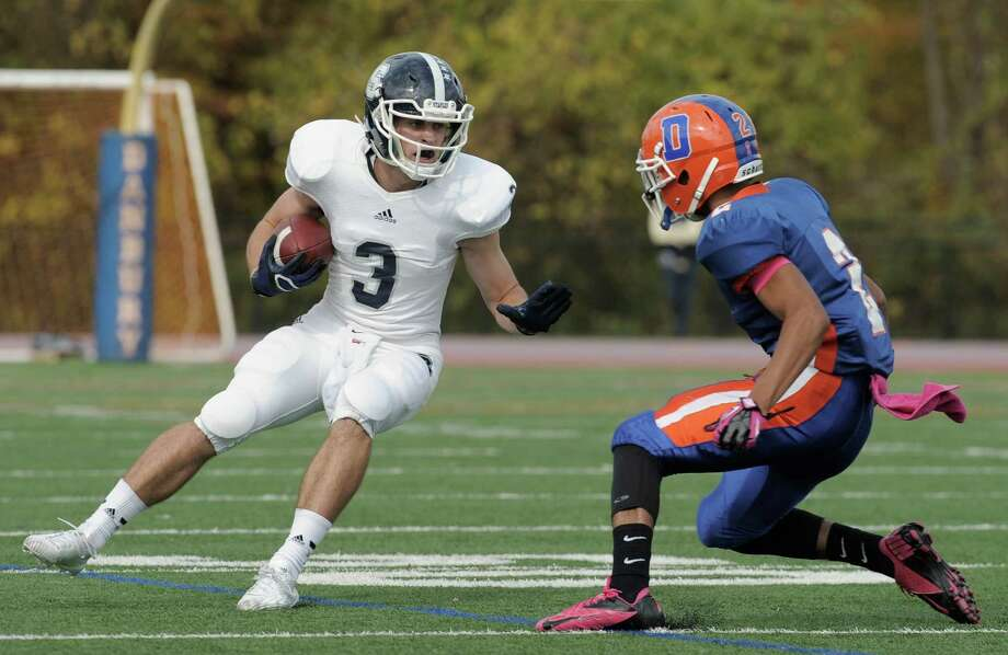 Photos from the Staples and Danbury High School boys football game on Saturday, October, 18, 2014, in Danbury, Conn. Photo: H John Voorhees III / The News-Times Staff Photographer