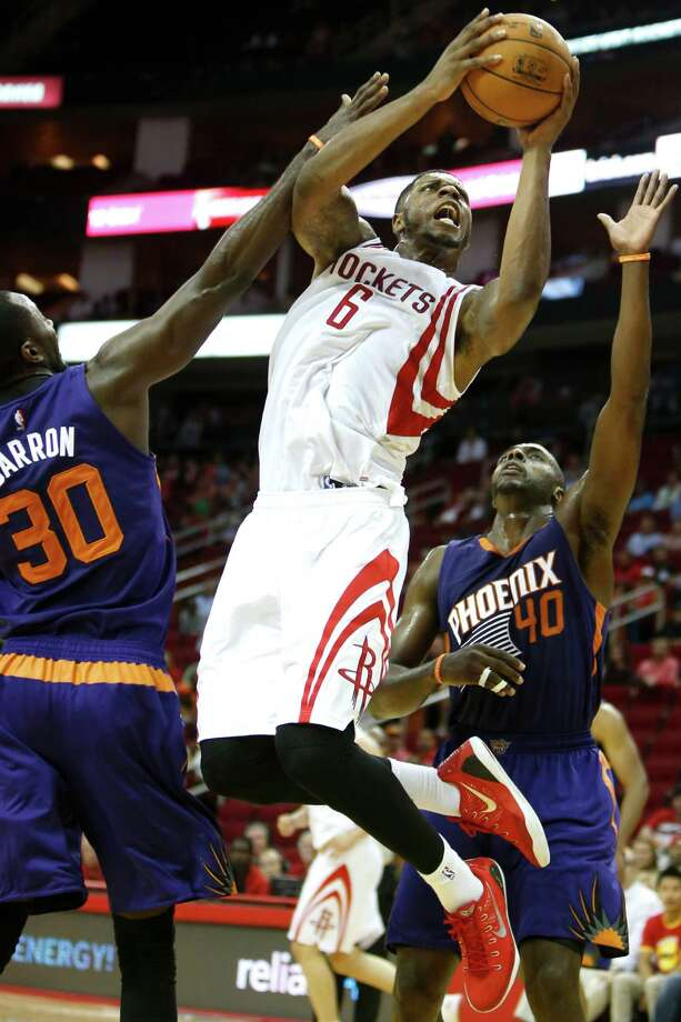 Injuries have scrambled the rotation, but a constant has been Terrence Jones, left, starting at power forward, replaced by Donatas Motiejunas, right. Photo: Brett Coomer, Staff / © 2014 Houston Chronicle