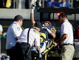 California wide receiver Trevor Davis gives a thumbs up while being carted off the field following an injury in the fourth quarter of a NCAA college football game against UCLA Saturday, Oct. 18, 2014, in Berkeley, Calif. UCLA won the game 36-34. (AP Photo/Eric Risberg)