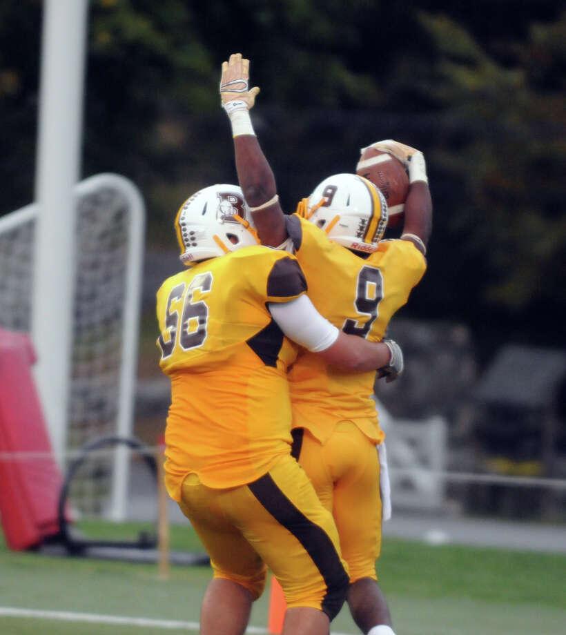 Patrick Adamo helps Jason Kennedy celebrate a touchdown as Brunswick hosts Salisbury in a football game in Greenwich, Conn., Oct. 18, 2014. Photo: Keelin Daly / Stamford Advocate Freelance