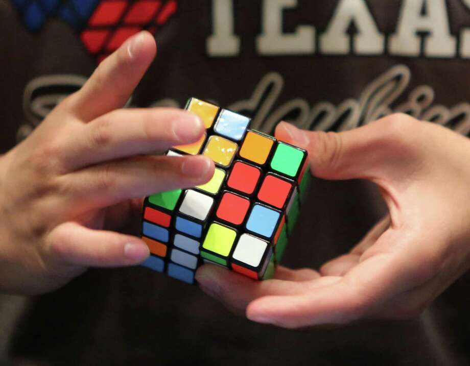 """Speedcuber"" Sammy Tawakkol competes in a World Cube Association sanctioned Rubik's Cube Competition at Rice University on Saturday, Oct. 18, 2014, in Houston. Photo: Mayra Beltran, Houston Chronicle / © 2014 Houston Chronicle"