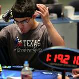 """Speedcuber"" Sammy Tawakkol reacts to slamming the rubies too hard upon completion and it shifted out of order during the Rubik's Cube Competition at Rice University on Saturday, Oct. 18, 2014, in Houston."