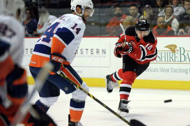 Devils Reid Boucher, right, shoots the puck as Tigers Justin Cournall defends during their hockey game on Saturday, Oct. 18, 2014, at Times Union Center in Albany, N.Y. (Cindy Schultz / Times Union) Photo: Cindy Schultz / 10028979A