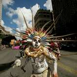 Francisco Flores of Danza Azteca Guadalupana dances in the 31st annual Viva la Vida parade in Austin, Texas, on Saturday, Oct. 18, 2014. The Viva la Vida Festival is Austin's largest and longest-running Day of the Dead celebration.  In addition to the parade, the event had Latino entertainment and food, art activities and community altars.