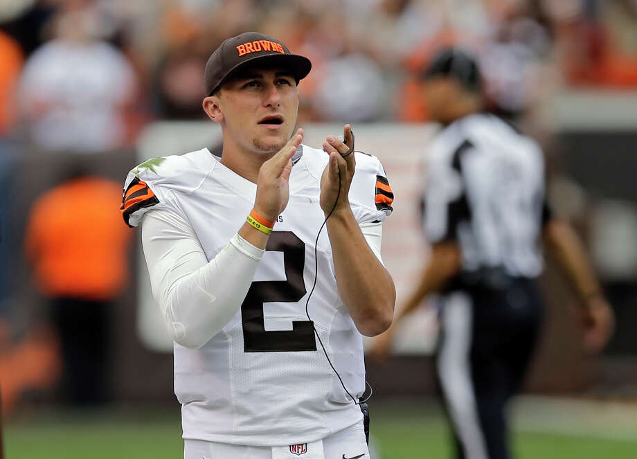 Cheering has become Johnny Manziel's primary duty with the Browns since he was relegated to the sideline as the backup QB. Photo: Tony Dejak, STF / AP