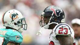 "Texans running back Arian Foster, right, gives Dolphins cornerback Jimmy Wilson an earful along with anyone else who crosses his path. When it comes to trash talking, Foster says those with ""bland personalities"" need not apply."