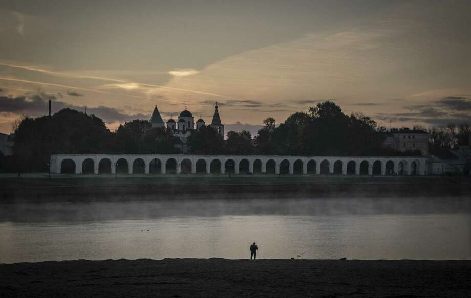 A fisherman walks the banks of the Volkhov River in Novgorod. Birch-bark scrolls and other artifacts buried for centuries in the mud here are revealing secrets about life in old Russia. Photo: New York Times / NYTNS