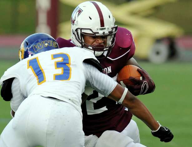 Union's Darnel Thomas (27) runs the ball while being defended by Western New England's Isaiah Berrios (13) during the first half of an NCAA college football on Saturday, Oct. 18, 2014, in Schenectady, N.Y. (Hans Pennink / Special to the Times Union) ORG XMIT: HP104 Photo: Hans Pennink / Hans Pennink