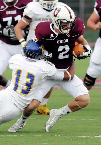 Union's Andrew Baker runs with the ball while being defended by Western New England's Isaiah Berrios (13) during the first half of an NCAA college football on Saturday, Oct. 18, 2014, in Schenectady, N.Y. (Hans Pennink / Special to the Times Union) ORG XMIT: HP106 Photo: Hans Pennink / Hans Pennink