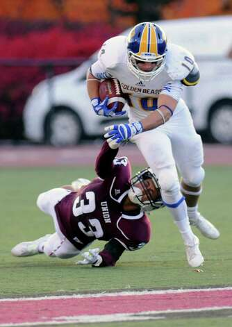 Union's Jasen Nelson (33) can't make the takel against Western New England's Tucker Schumitz (10) during the first half of an NCAA college football on Saturday, Oct. 18, 2014, in Schenectady, N.Y. (Hans Pennink / Special to the Times Union) ORG XMIT: HP109 Photo: Hans Pennink / Hans Pennink
