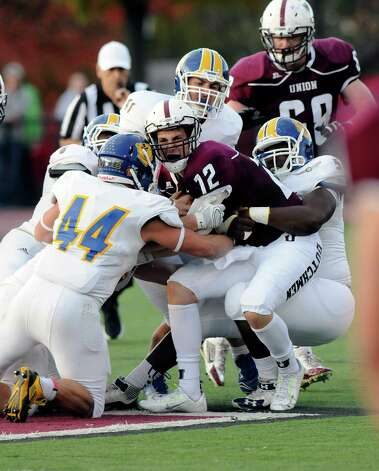 Union quarterback Dante Cioffi (12) is sacked by the Western New England defence during the first half of an NCAA college football on Saturday, Oct. 18, 2014, in Schenectady, N.Y. (Hans Pennink / Special to the Times Union) ORG XMIT: HP111 Photo: Hans Pennink / Hans Pennink