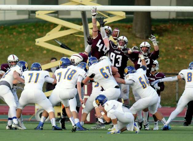 Union players try to block a extra point attempt by Western New England during the second half of an NCAA college football on Saturday, Oct. 18, 2014, in Schenectady, N.Y. (Hans Pennink / Special to the Times Union) ORG XMIT: HP115 Photo: Hans Pennink / Hans Pennink