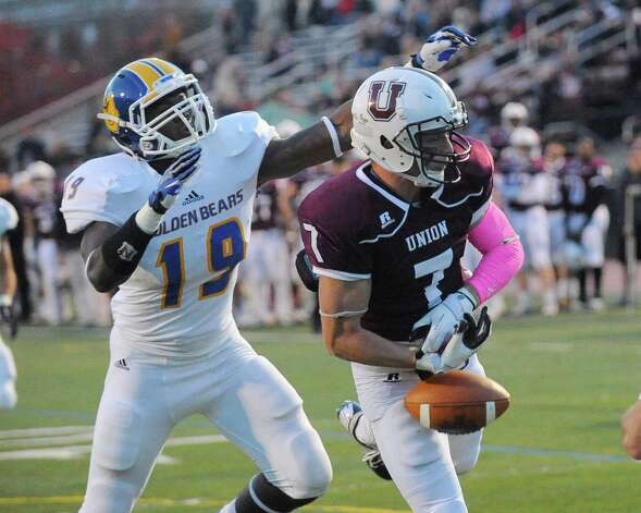 Union's Josh Callahan (7) can't hang on to a pass in the end zone while being defended by Western New England's Hezekiah Duncan (19) during the second half of an NCAA college football on Saturday, Oct. 18, 2014, in Schenectady, N.Y. (Hans Pennink / Special to the Times Union) ORG XMIT: HP118 Photo: Hans Pennink / Hans Pennink