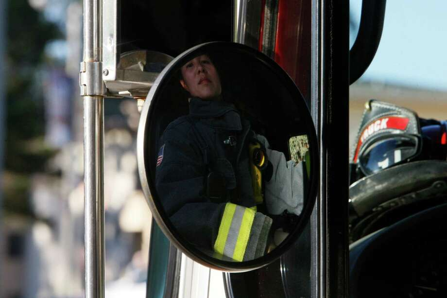 Lt. Patty Lui steers a fire engine into Station 19 in San Francisco on Oct. 18, 2014. Lui is participating in a study to determine whether female firefighters are particularly vulnerable to breast cancer. Photo: Terray Sylvester / The Chronicle / ONLINE_YES
