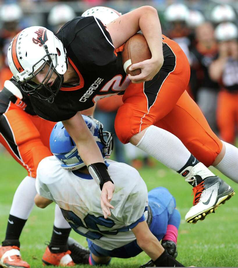 Cambridge's Chris Warnke, top, avoids a tackle on his way to a touchdown during their football game against Hoosic Valley on Saturday, Oct. 18, 2014, at Cambridge High in Cambridge, N.Y. (Cindy Schultz / Times Union) Photo: Cindy Schultz / 00029061A