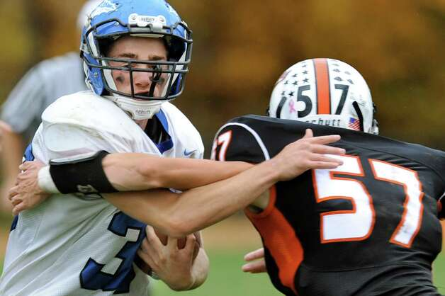 Hoosic Valley's Mark Delude, left,  fights off a tackle from Cambridge's Colton Eastman during their football game on Saturday, Oct. 18, 2014, at Cambridge High in Cambridge, N.Y. (Cindy Schultz / Times Union) Photo: Cindy Schultz / 00029061A