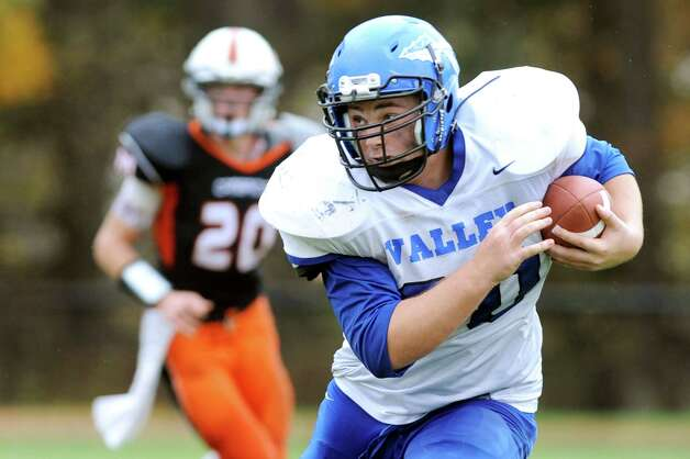 Hoosic Valley's Nick Napoli, right, carries the ball during their football game against Cambridge on Saturday, Oct. 18, 2014, at Cambridge High in Cambridge, N.Y. (Cindy Schultz / Times Union) Photo: Cindy Schultz / 00029061A
