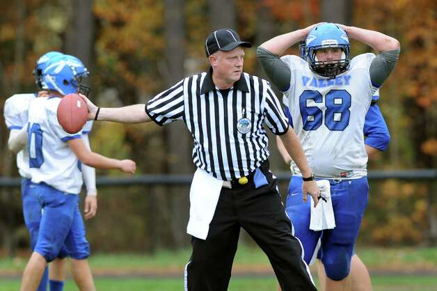 Hoosic Valley's Jeff Carrozza, right, reacts when his team loses the ball in a turnover during their football game against Cambridge on Saturday, Oct. 18, 2014, at Cambridge High in Cambridge, N.Y. (Cindy Schultz / Times Union) Photo: Cindy Schultz / 00029061A