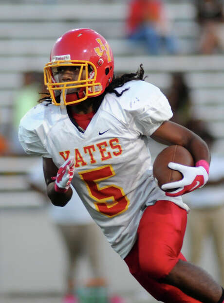 Anthony Martin of Yates rushed for 118 yards and four touchdowns against Waltrip on Saturday. Photo: Jerry Baker, Freelance