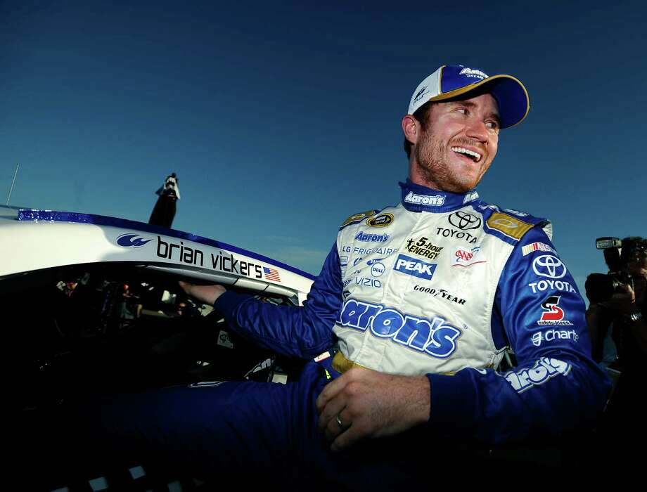 Brian Vickers is all smiles Saturday after winning the pole for Sunday's NASCAR Sprint Cup Series race at Talladega Superspeedway. Photo: Rainier Ehrhardt, FRE / FR155191 AP