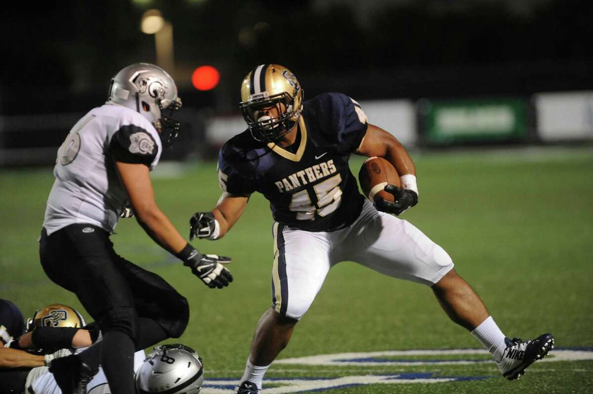 O'Connor's Josiah Velazquez carries the ball against Clark during 27-6A boys football action at Farris Stadium on Saturday, Oct. 18, 2014. The