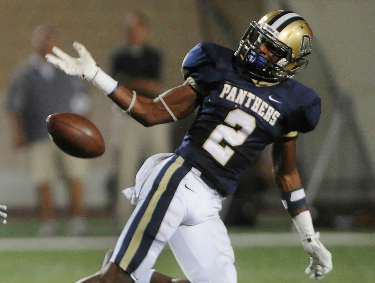 O'Connor defender Darryl Godfrey can't hold on to the football for a potential interception during 27-6A boys football action against Clark at Farris Stadium on Saturday, Oct. 18, 2014. The