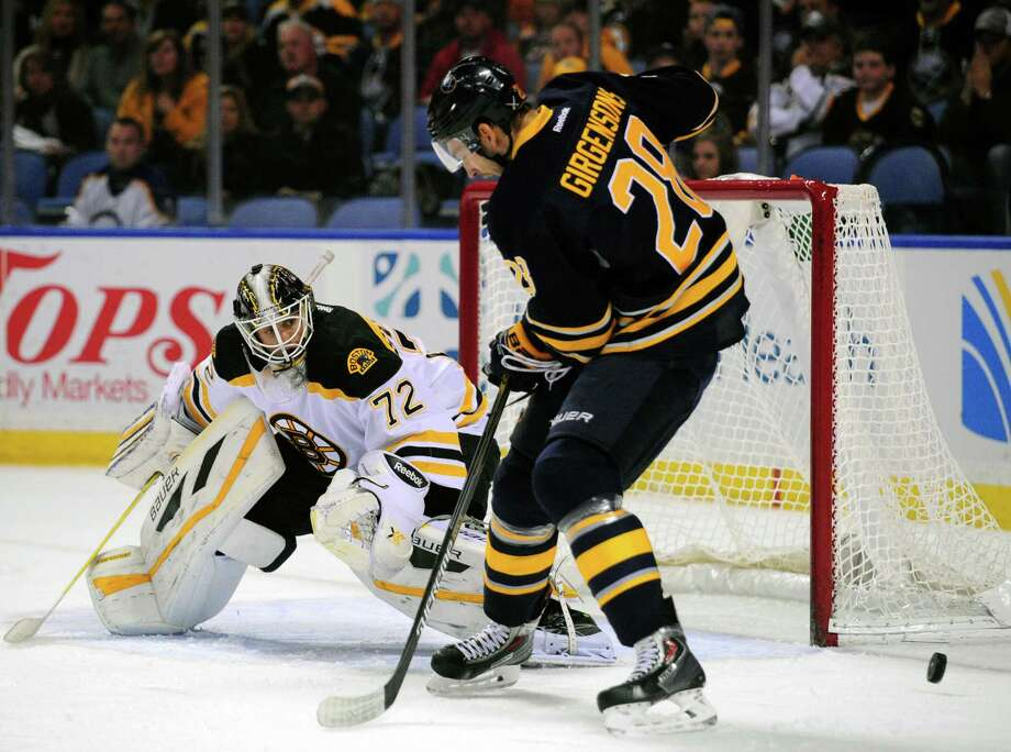 Boston Bruins goaltender Niklas Svedberg (72), of Sweden, watches the deflection of a shot by Buffalo Sabres center Zemgus Girgensons (28), of Latvia, during the first period of an NHL hockey game in Buffalo, N.Y., Saturday, Oct. 18, 2014. (AP Photo/Gary Wiepert) ORG XMIT: NYGW101 Photo: Gary Wiepert / FR170498 AP