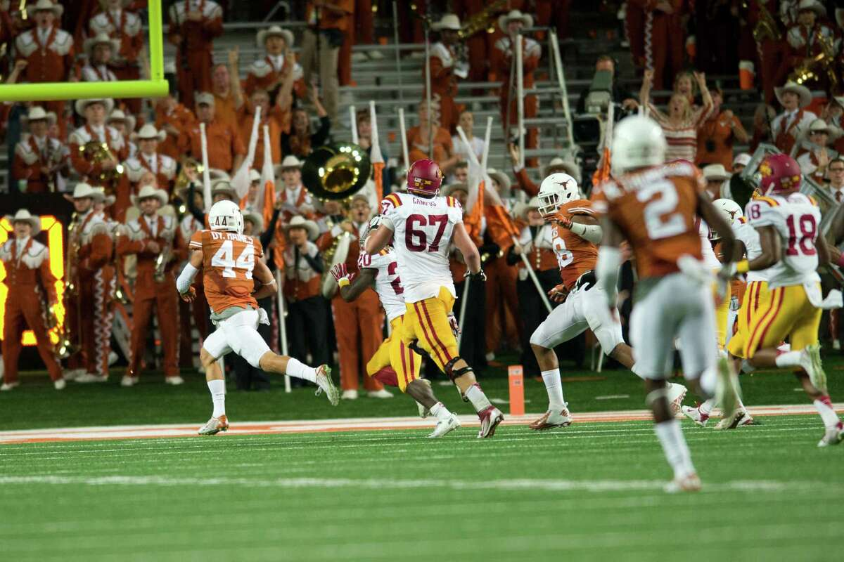 AUSTIN, TX - OCTOBER 18: Dylan Haines #44 of the Texas Longhorns returns an interception 74 yards for a touchdown against the Iowa State Cyclones during the 2nd quarter on October 18, 2014 at Darrell K Royal-Texas Memorial Stadium in Austin, Texas.